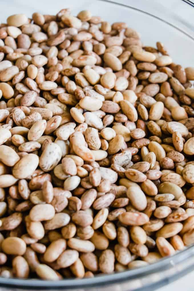 A bowl filled with pinto beans ready to be made into charro beans.