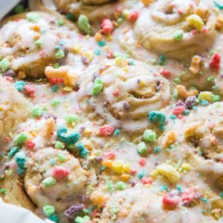 Overnight Fruit Loop Sweet Rolls made with cereal milk! Get a head start on breakfast by prepping these Fruit Loop sweet rolls the night before! Made with actual fruity cereal milk, loaded with pieces of fruit loops, and all drizzled with a fruity cereal milk glaze. These will always win the prize for the most fun breakfast!