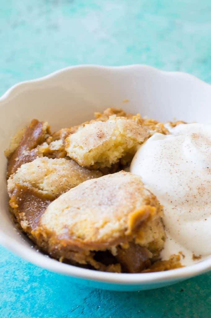 Pumpkin Snickerdoodle Cobbler. A winning combination of pumpkin pie filling with a snickerdoodle topping. Making this the perfect Fall dessert!