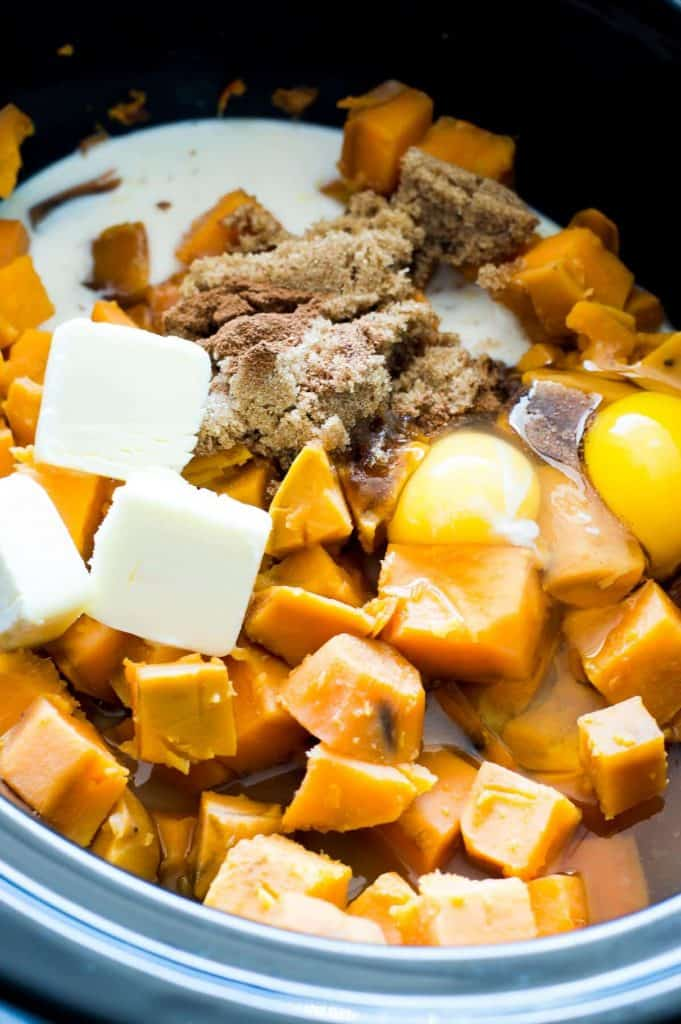 Sweet, creamy brown sugar sweet potatoes with a hint of bourbon and topped with a velvety brown sugar sauce and crunchy pecans! This side dish is made even EASIER by using the slow cooker! The perfect dish for Fall and all Holidays!