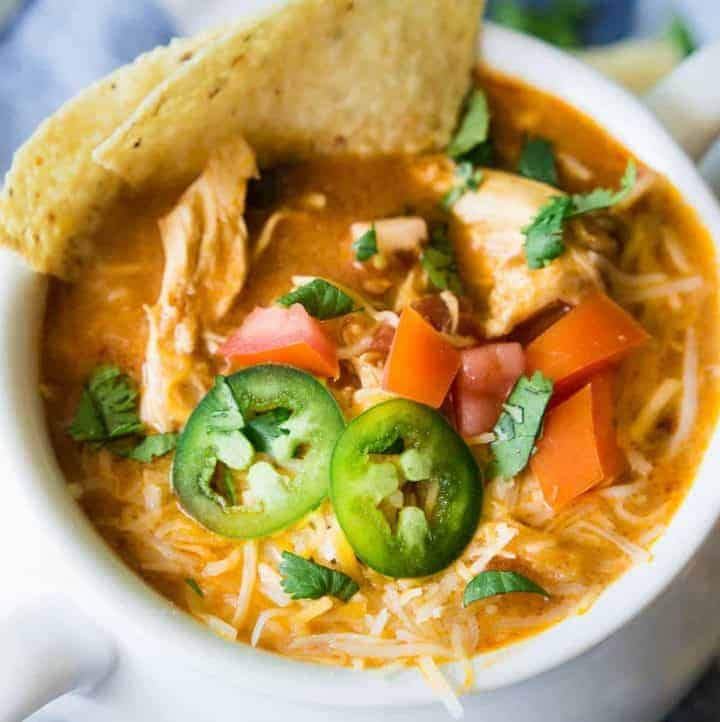 Slow Cooker King Ranch Chicken Soup. This EASY soup tastes just like the beloved King Ranch Chicken Casserole. Loaded with cheese, juicy chunks of chicken, and tons of flavor! Simply load up the slow cooker and let this soup simmer during the day so you can enjoy this for dinner!