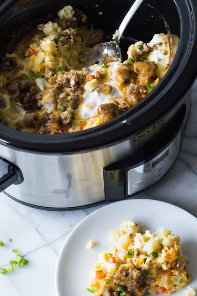 Slow Cooker Breakfast Casserole. This quick and easy to put together breakfast can cook in the slow cooker overnight while you're sleeping!! There's nothing better than waking up to the smell of a homemade breakfast already made. This casserole is loaded up with sausage, diced hash browns, eggs and cheese.
