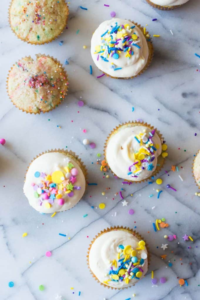 The Perfect Homemade Funfetti Cupcake with Vanilla Buttercream. Fluffy cake loaded with sprinkles for bits of fun and color. All topped with a creamy, homemade vanilla buttercream. And more sprinkles of course! So easy to make and sure to be a big hit!
