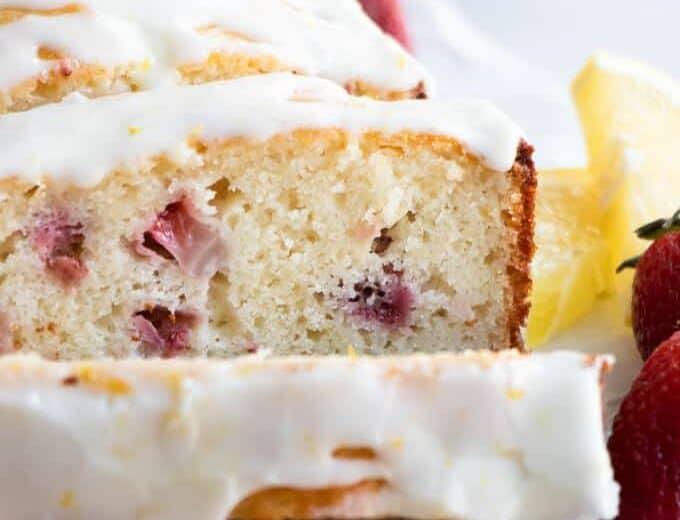 Sliced strawberry lemon pound cake with a lemon glaze.