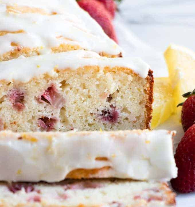 Sliced strawberry lemon pound cake with a lemon glaze.