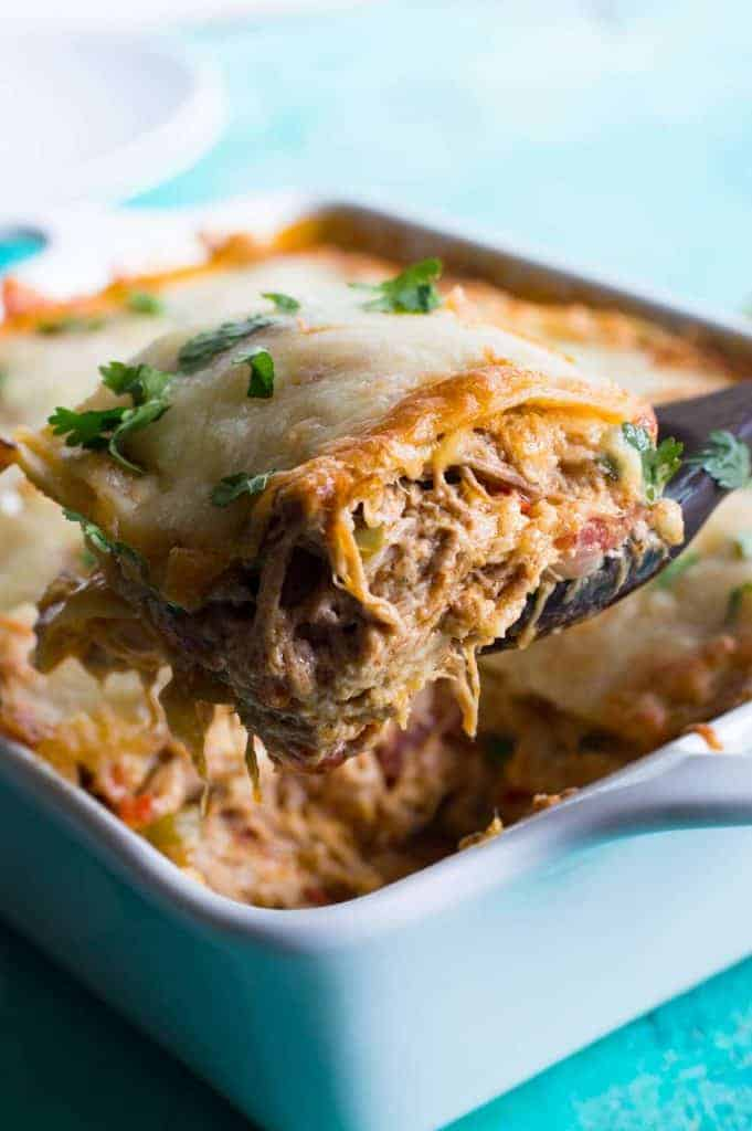 Pulled Pork King Ranch Casserole. The classic casserole famous in Texas gets a little bit of a makeover using tender juicy pulled pork! Layers of crisp tortillas, a chili powder spiked cream sauce with smokey tender pork, and melted cheese. This dish is perfect for get togethers or potlucks!