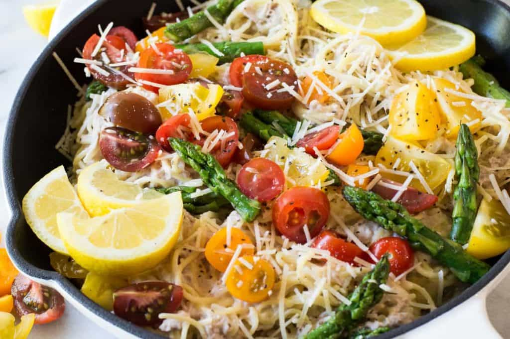Creamy Lemon Pasta with Tuna. The perfect springtime dish! Asparagus, tomatoes, tuna and pasta noodles all coated in a creamy lemon sauce. Easy to make, sure to please, and loaded with fresh flavors and colors!