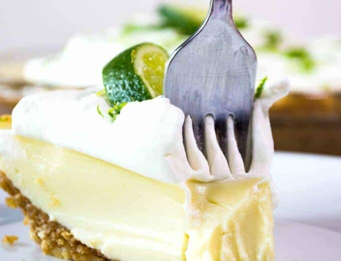 Tequila Lime Pie! An ultra creamy, lime pie laced with a hint of tequila! Almost like enjoying a bite of margarita!
