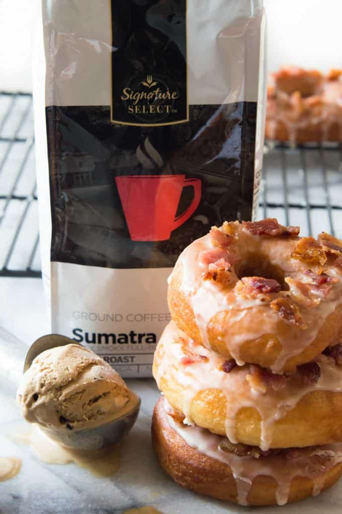 Donut Ice Cream Sandwiches! These easy to make yeast donuts are light and fluffy just like the bakery version and come together fairly quickly! Dress it up with some coffee glaze, bacon crumbles and fill with some coffee flavored ice cream for the ultimate treat.