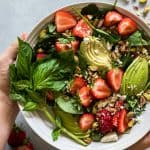 Strawberry Avocado and Pistachio Salad with a Creamy Poppyseed Dressing. All the best flavors combine in this salad. Baby spinach loaded up with juicy fresh strawberries, salty pistachios and creamy avocado. Drizzle it all with an easy to make and lighter poppyseed dressing.