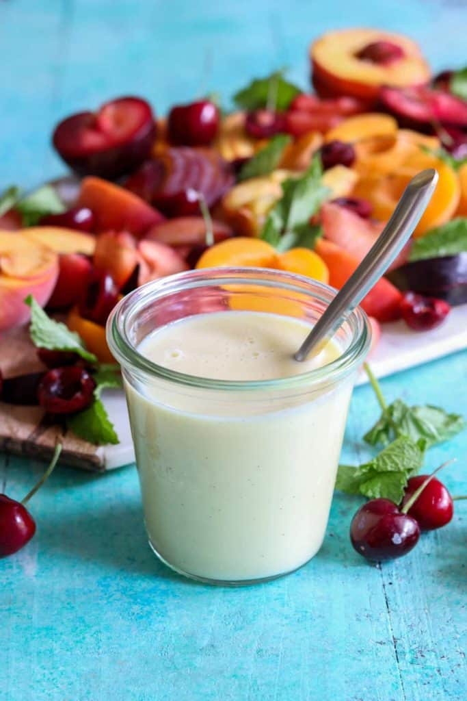 Stone Fruit Salad with Custard Cream Sauce.  This fruit salad is loaded up with peaches, nectarines, plums, and cherries.  Drizzled with a creamy and easy to make custard sauce this fruit salad is completely dreamy!