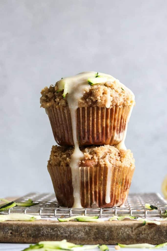 Zucchini Crumb Muffins with Lemon Cream Cheese Glaze.  These muffins are loaded up with fresh zucchini, spiced up with a hint of cinnamon, and made lighter by using greek yogurt!  Not to mention the sweet hint of crumb topping baked right into the muffin.  Top it all off with a drizzle of lemon cream cheese glaze.