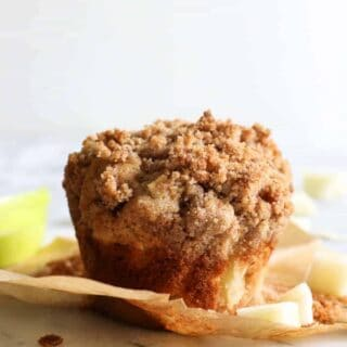 Apple Crumb Muffins.  Light and fluffy bakery style muffins loaded up with bits of fresh apple and spiced with a hint of cinnamon.  All topped off with a delicate brown sugar crumble