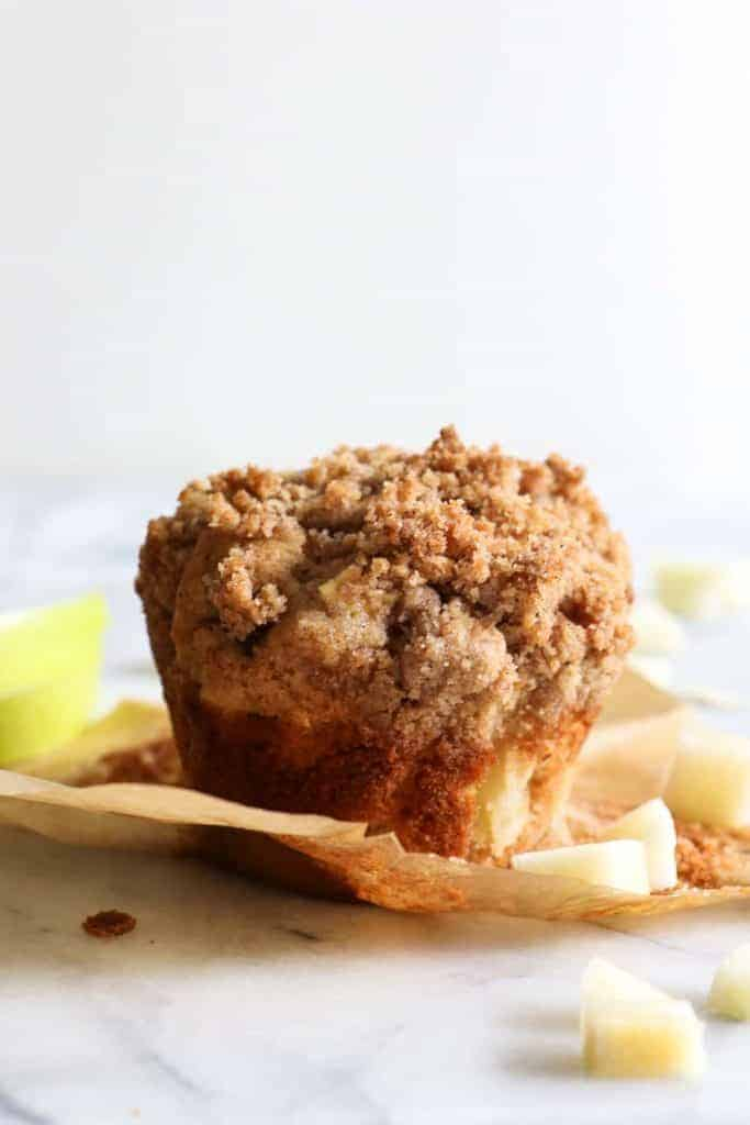 Single Apple Crumb Muffin with the wrapper removed.