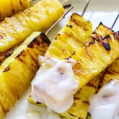 Grilled Pineapple with Coconut Rum Sauce.  Sweet, juicy, caramelized grilled pineapple drizzled with a creamy coconut rum sauce.  Tropical paradise!