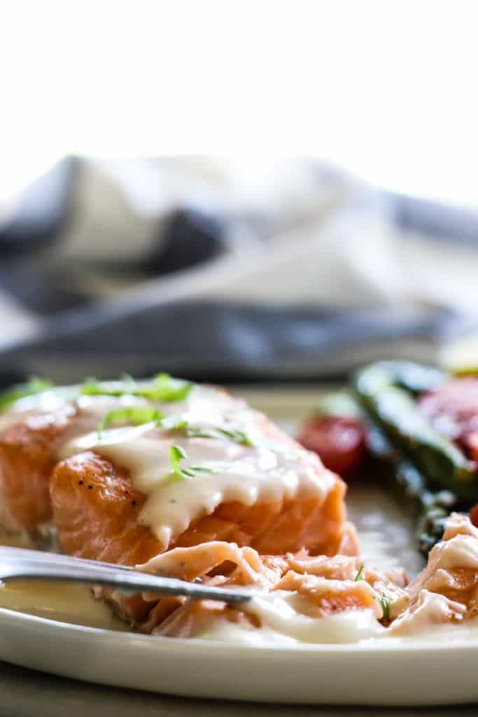 This easy to make Baked Salmon is topped with a flavorful, creamy Parmesan Cheese Sauce. Less than 30 minutes needed for this easy dinner recipe!