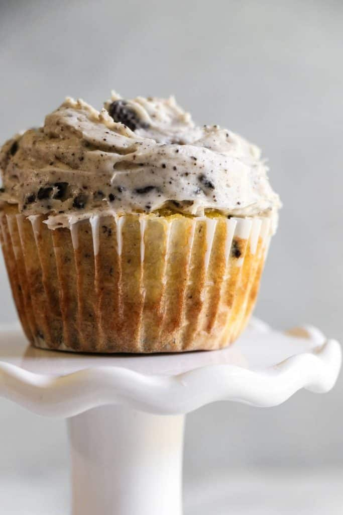 These Cookies and Cream Cupcakes are loaded with not just chunks of oreo, but an entire oreo on the bottom. All topped off with a beyond creamy cookies n cream frosting.
