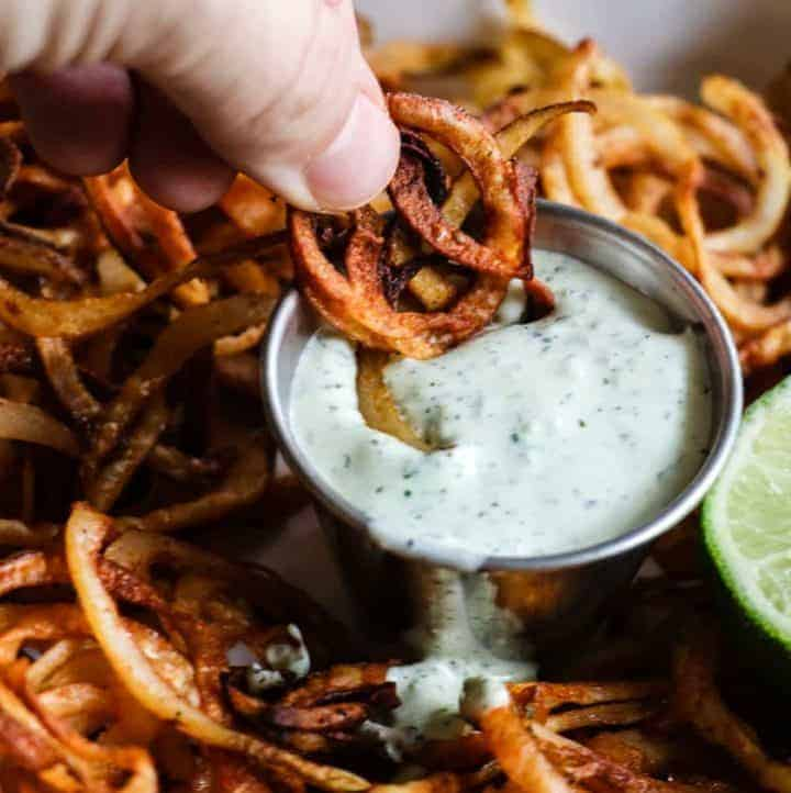 Homemade crispy fries seasoned with chile powder and hit with a dose of lime. Perfect side dish to any Mexican dish or just snacking on!