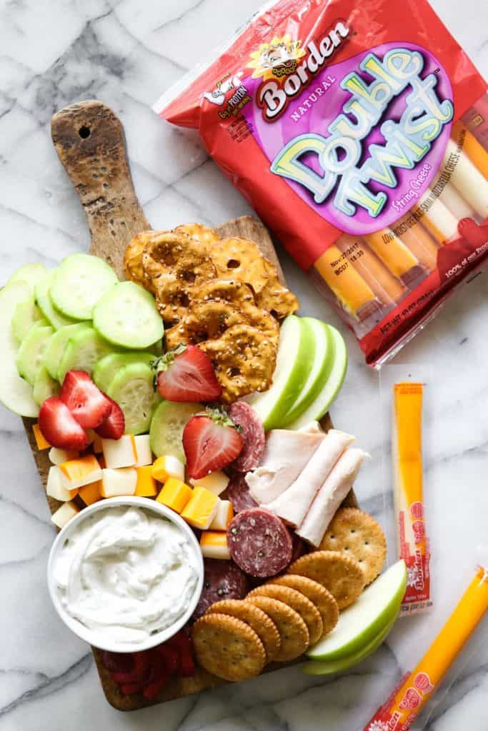 Kid Friendly Cheese Board!  Kids will happily devour every last bite of this kid friendly cheese board.  Serve as a lunch or after school snack tray.