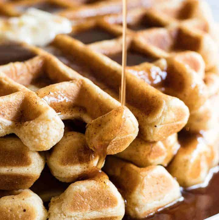 Light and fluffy waffles made with eggnog and drizzled with a homemade cinnamon syrup.