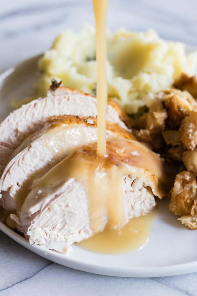 Tender and juicy turkey perfect for Thanksgiving day. Plus instructions on how to make turkey stock, gravy and stuffing too!