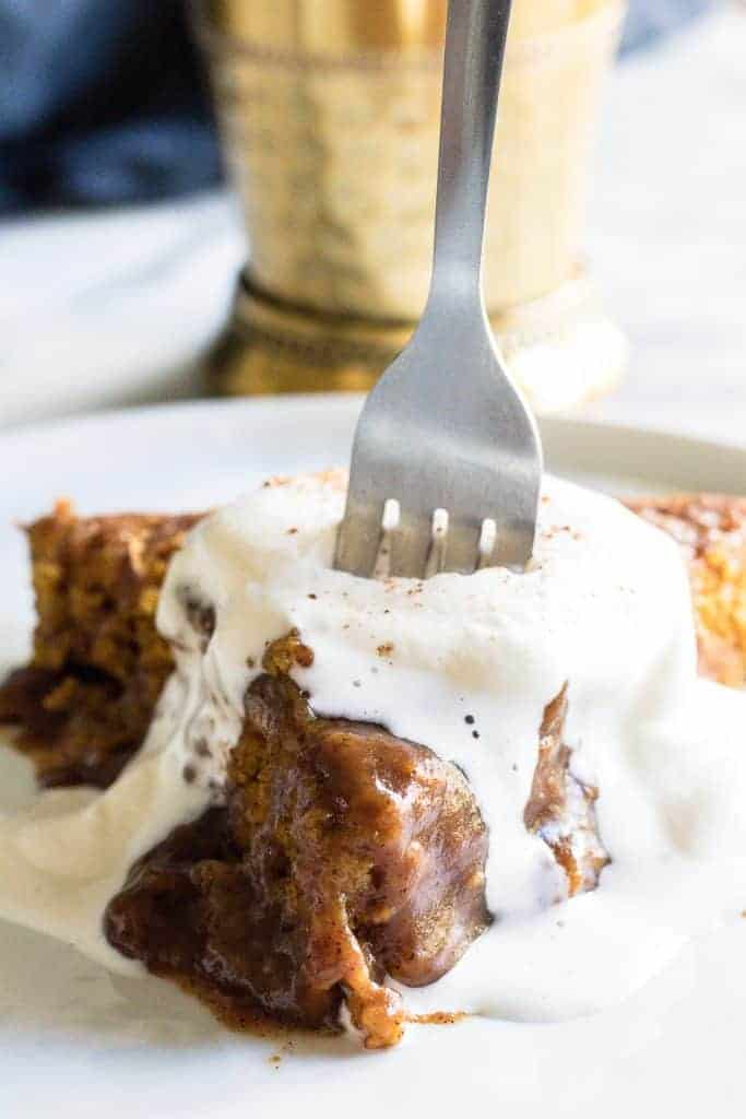Pumpkin Chai Cobbler, a magical cake made by pouring hot chai tea over a pumpkin batter that bakes into a cake with a layer of a caramel like sauce underneath.