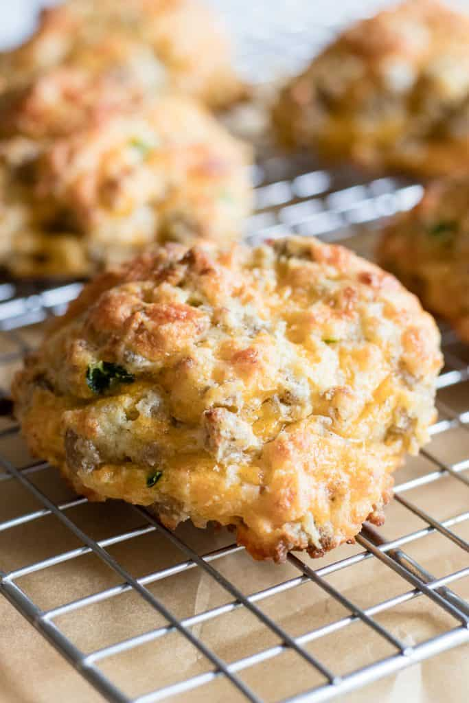 These soft and fluffy buttermilk biscuits are loaded up with cheese, bits of sausage and jalapeño. Perfect for breakfast or snack!