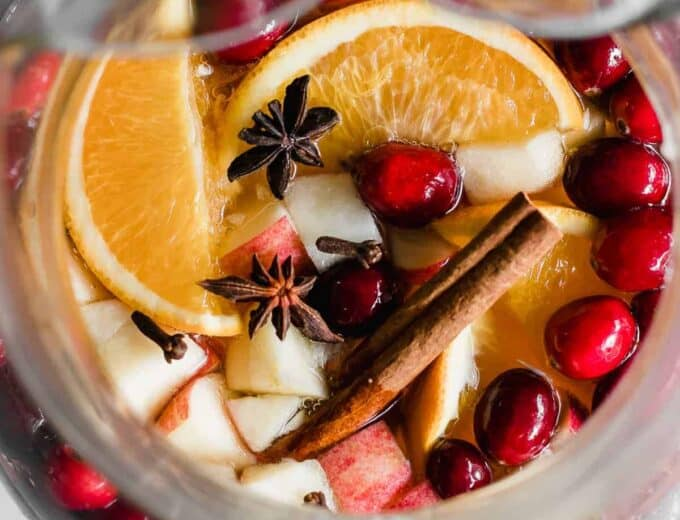 Sparkling Apple Cider Sangria. Sparkling Apple cider loaded up with chunks of apple, orange, cranberries, and all the best fall spices. No alcohol included makes this perfect for the entire family!