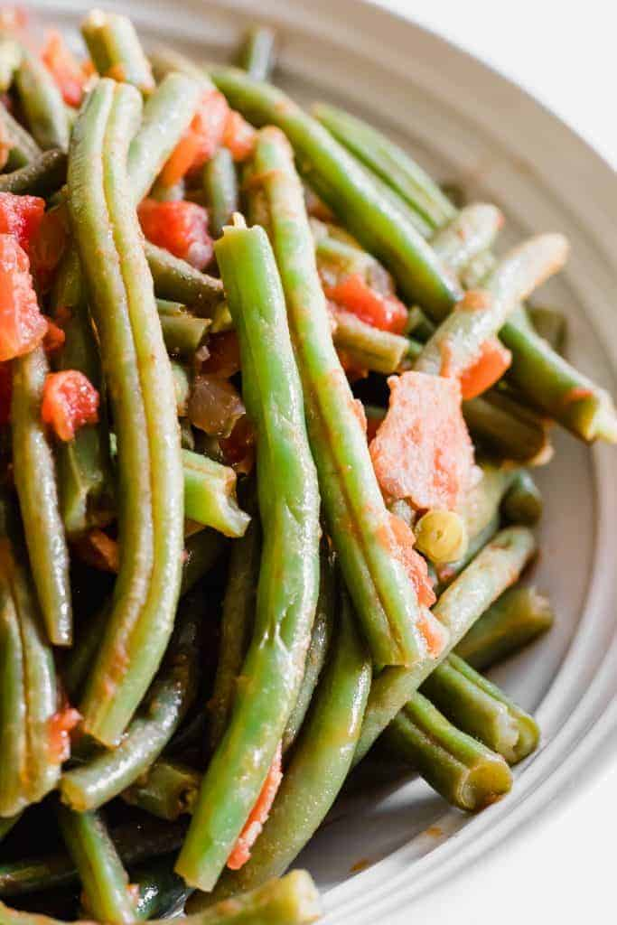 This green bean dish is easy to make and loaded with flavor from the bacon!  Perfect gluten free option for a Holiday side dish!