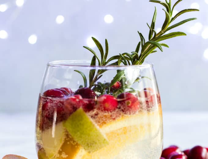 Sparkling White Sangria. This festive drink is super easy to put together and definitely makes a statement. Loaded with cranberries, pears, and oranges this drink is perfect for celebrating the Holidays!