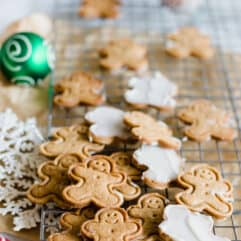 Gingerbread Cookies with White Fudge Icing. These little gingerbread cookies are soft and crisp, perfectly sweet and spiced with cinnamon and ginger. The finishing touch is the white fudge icing on the back! A homemade take on a market favorite!