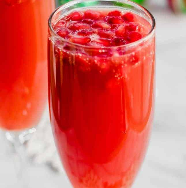 Christmas Mimosas! Celebrate Christmas in the morning with this mimosa that has a combination of orange juice and pomegranate juice!