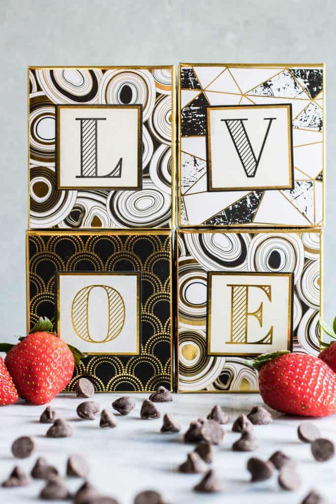 Debi lilly design alphabet candles spelling out LOVE with strawberries and chocolate chips.