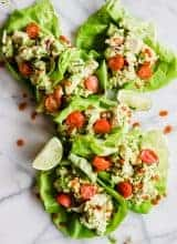 Lettuce cups filled with avocado chicken salad.