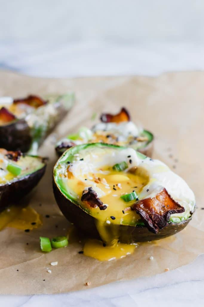 Avocado Baked Eggs with runny yolk and bacon