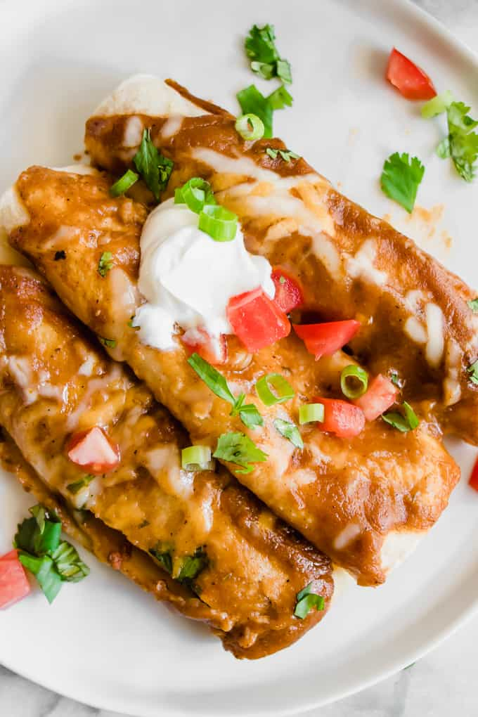Chorizo enchiladas smothered with a homemade enchilada sauce.