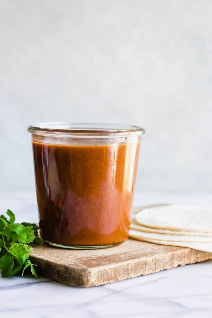Jar of homemade enchilada sauce recipe.