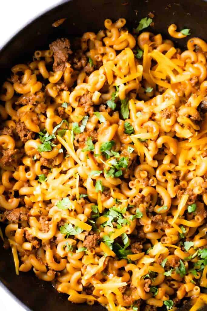 Skillet filled with taco pasta.