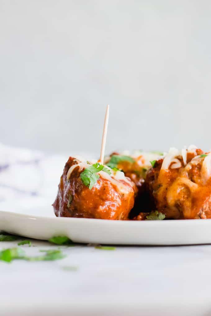 Tex Mex Chorizo Enchilada Meatballs on a plate with toothpicks.