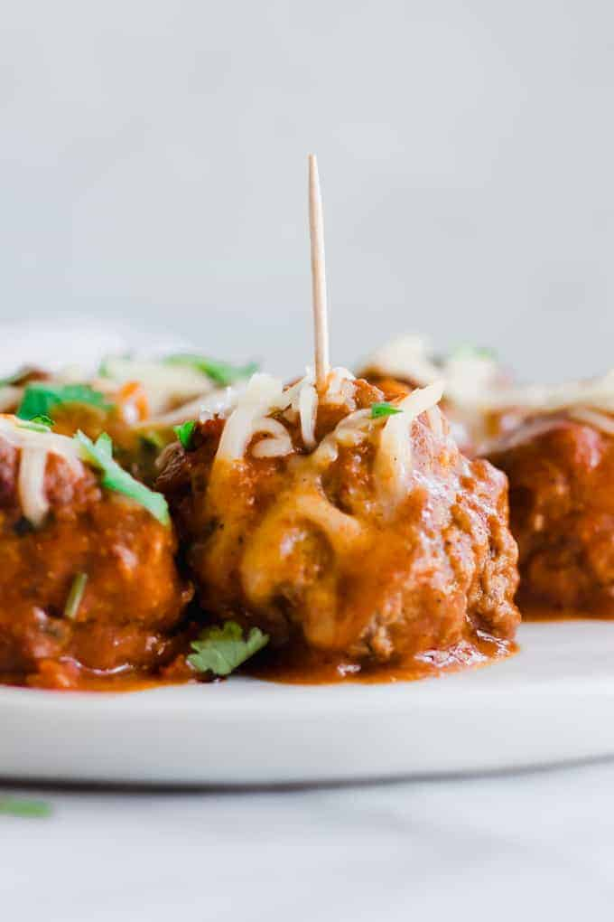 Tex Mex Chorizo Enchilada Meatballs on a plate with toothpicks.