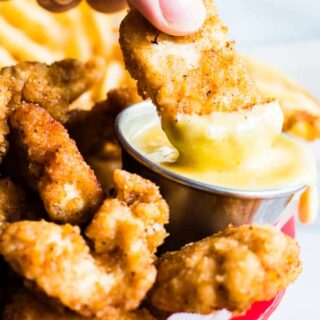Copycat chick fil a nugget dipping into chick fil a sauce.