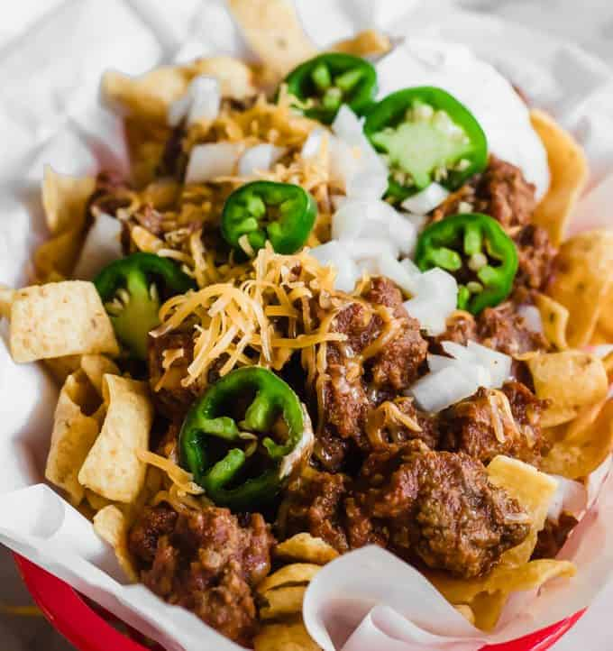 Tray filled with Frito pie made with 20 minutes Texas chili.