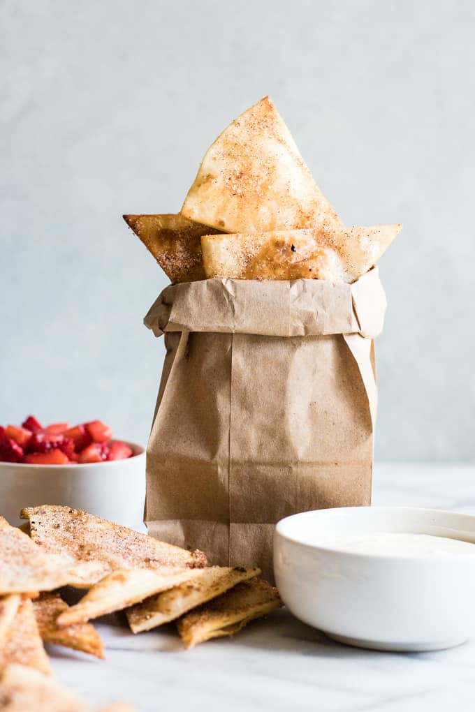 Small brown paper bag filled with cinnamon tortilla chips.