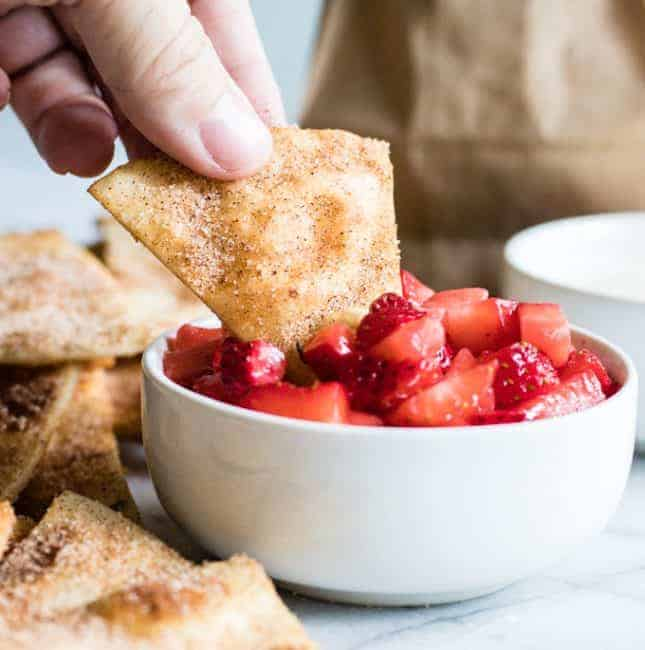 Cinnamon Tortilla Chips dipping into strawberry salsa.