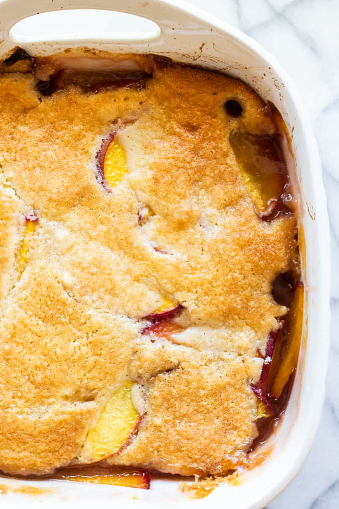 Dish with cooked peach cobbler.