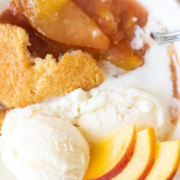 Fresh Baked Peach Cobbler. Loaded with fresh peaches and topped with vanilla ice cream.