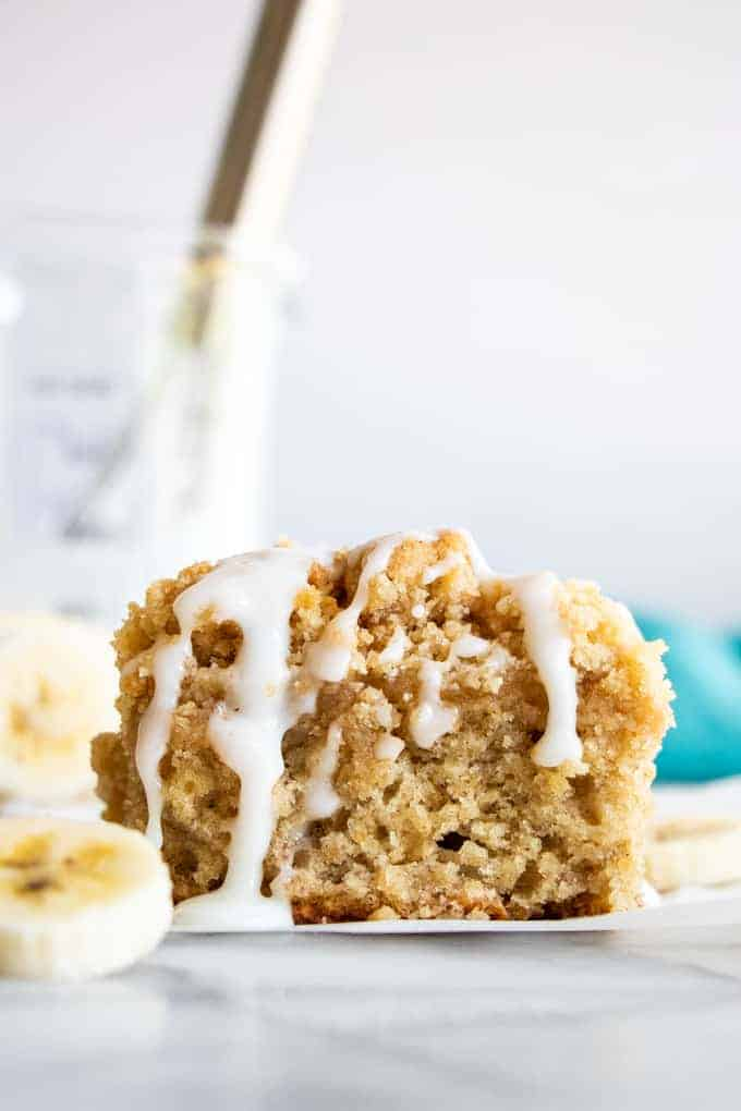 Slice of Banana Bread Crumb Cake with a drizzle of icing.