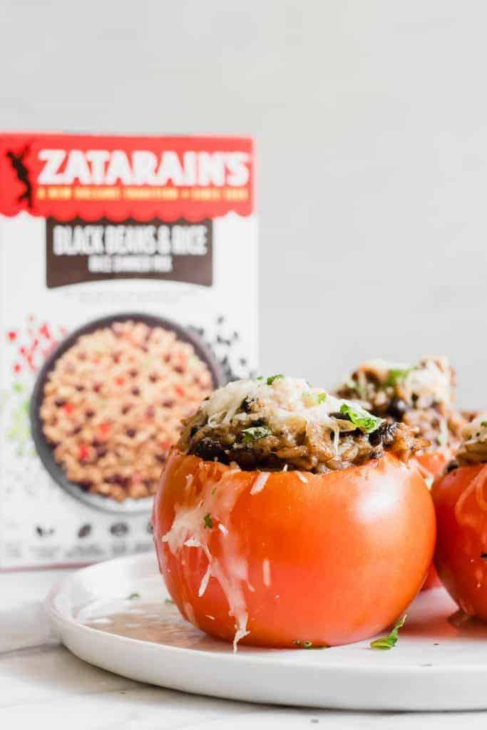 Black beans and rice stuffed tomatoes featuring Zatarain's Rice Dinner Mix.