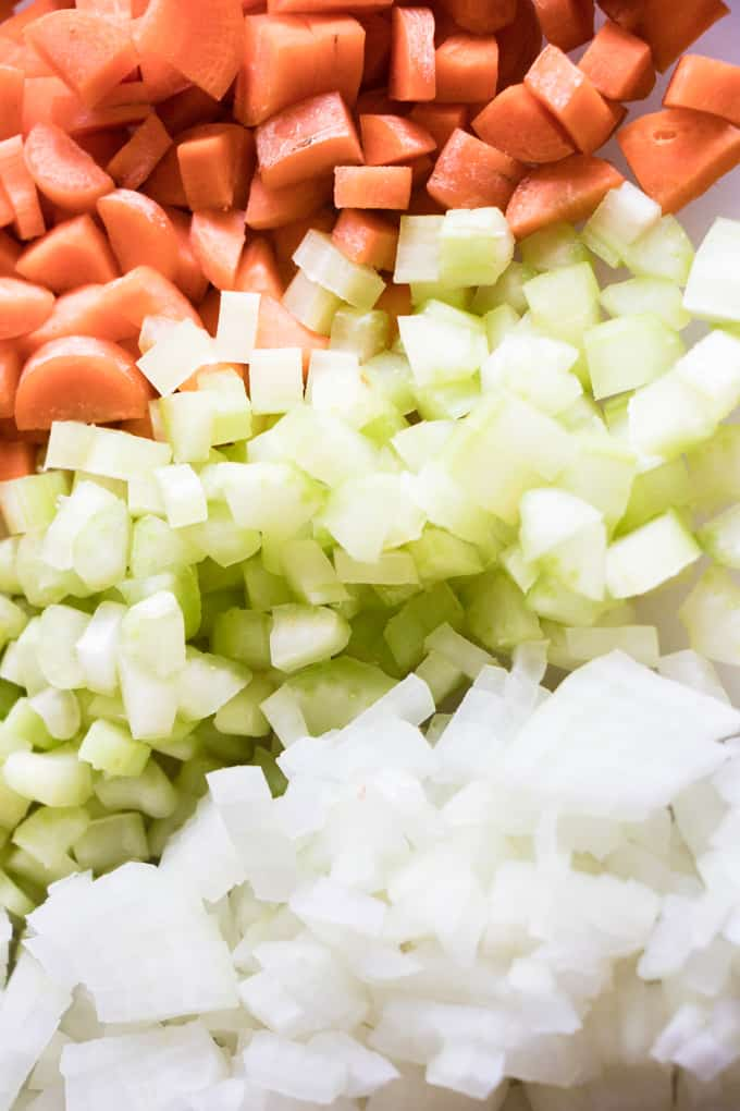 Diced up carrots, celery, and onion ready for chicken pot pie soup.