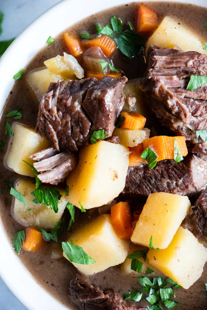 Bowl filled with ultra comforting beef stew! This classic recipe is made with chuck roast, potato and carrots.